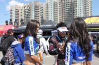 Daijiro Yoshihara collecting donations with the Umbrella Girls!
